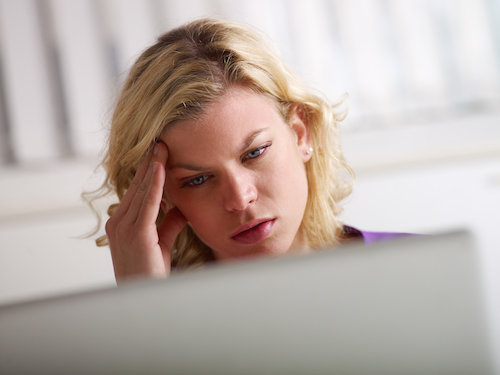Headache and health problems for young woman at work