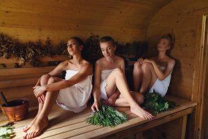 three girls enjoying the sauna