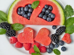 watermelon and fruits cut into a heart shape