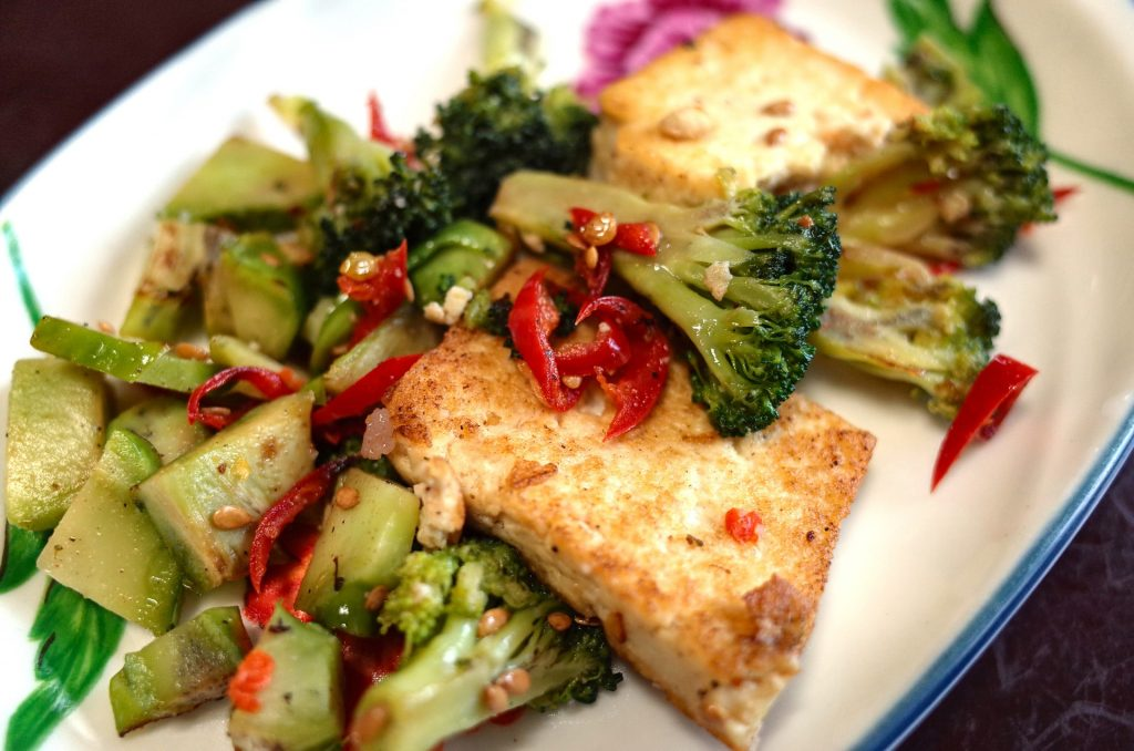 vegan stir fry dish with high-calcium vegan foods tofu broccoli and peppers