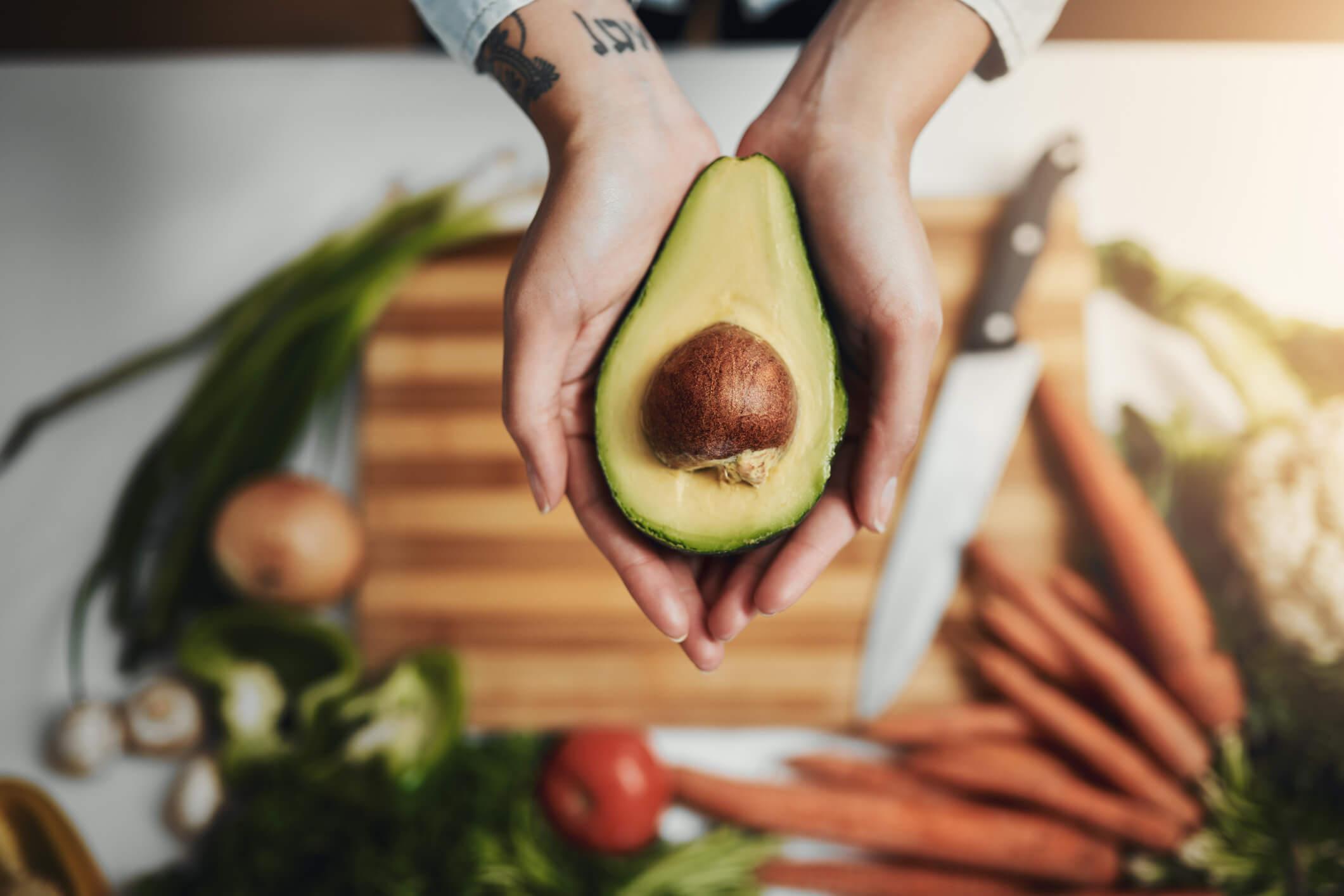 woman preparing an avocado