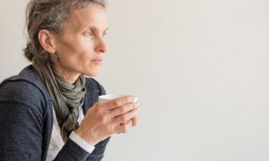 woman with perimenopause pondering the changes in her life.
