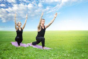 man and woman yoga exercise
