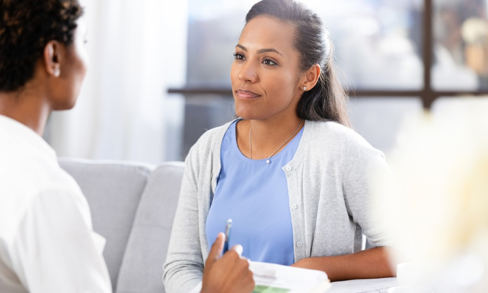 A woman consulting her Dr. about treatments for ovarian cysts.