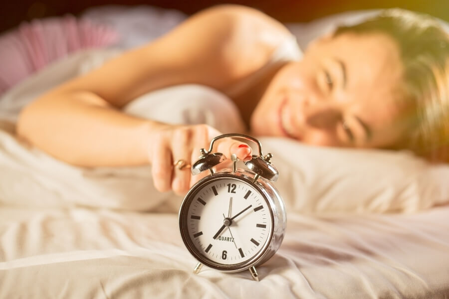 Woman waking up early